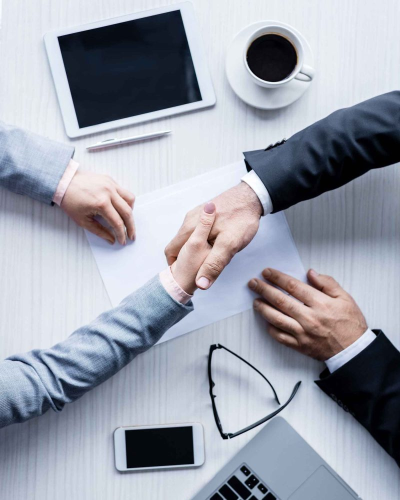 top-view-of-business-people-shaking-hands-during-m-5LE7MCE.jpeg